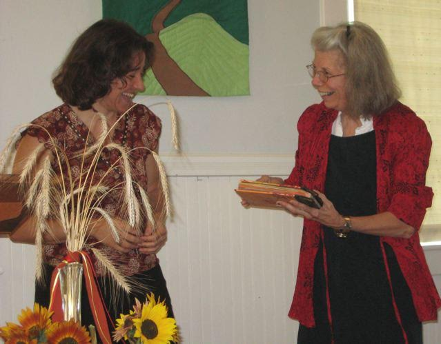 Lynda presenting Samantha with a book of blessings and remembrance
